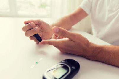 close-up-of-man-checking-blood-sugar-by-P5GJ8BD-small-1.jpg