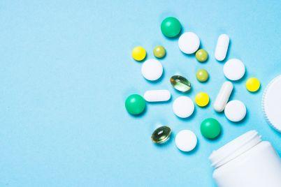 pills-tablets-and-vitamin-on-blue-P2NE56S.jpg