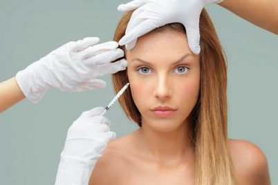 young-woman-with-doctor-hands-injecting-botox-PVKHPRX-small-e1553244193566.jpg